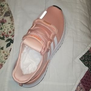 Pink and white stripes Adidas running shoes
